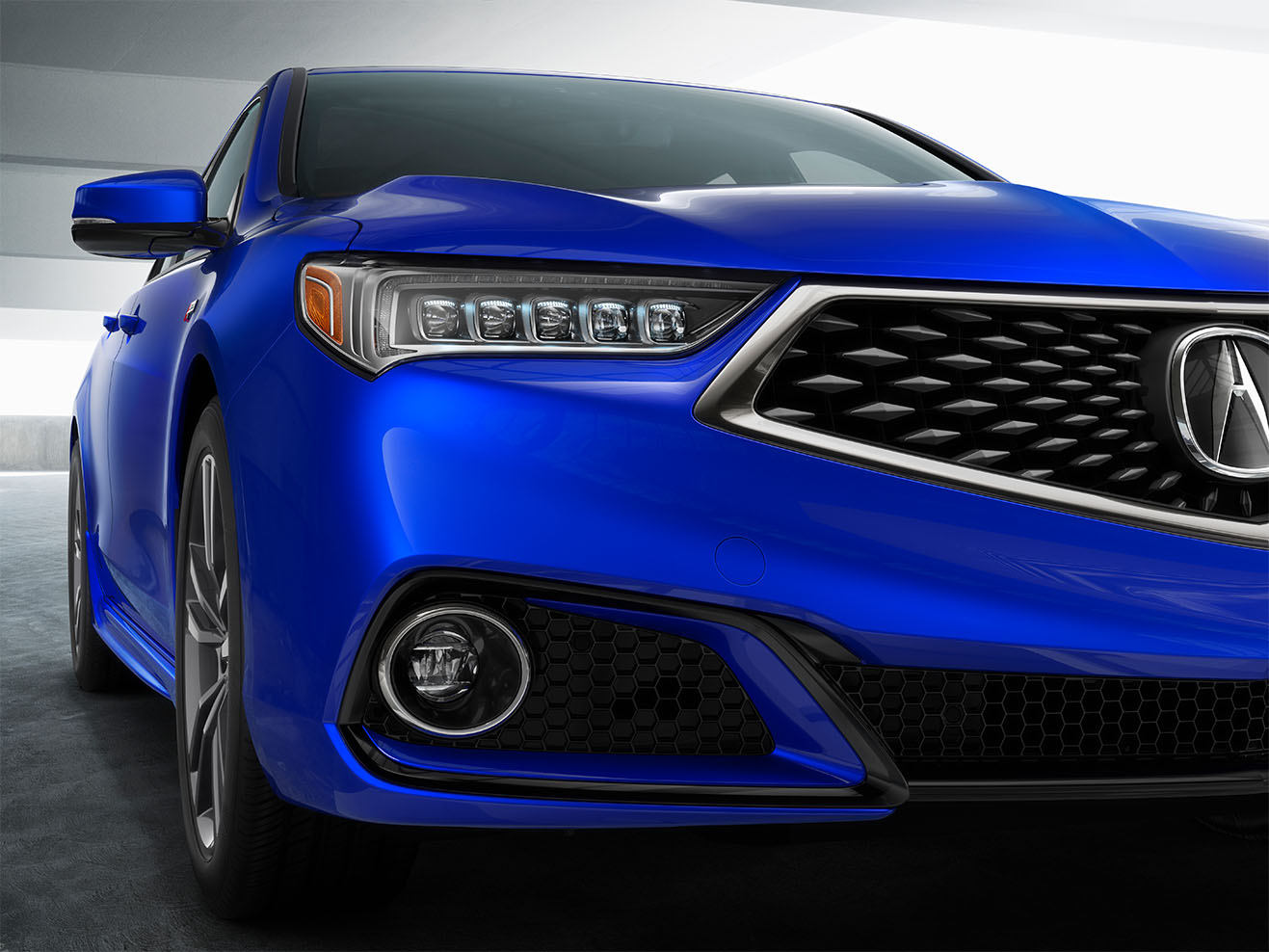 Blue Acura TLX Front Passenger side headlight view